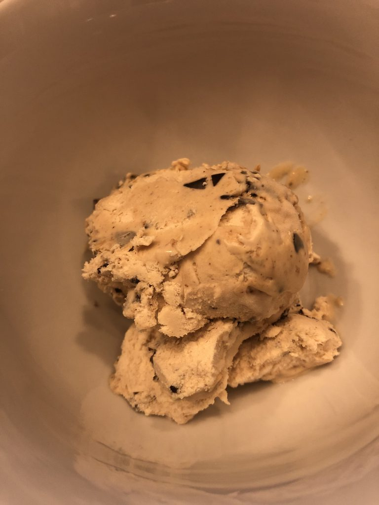 Peanut butter fudge ice cream sits in a bowl